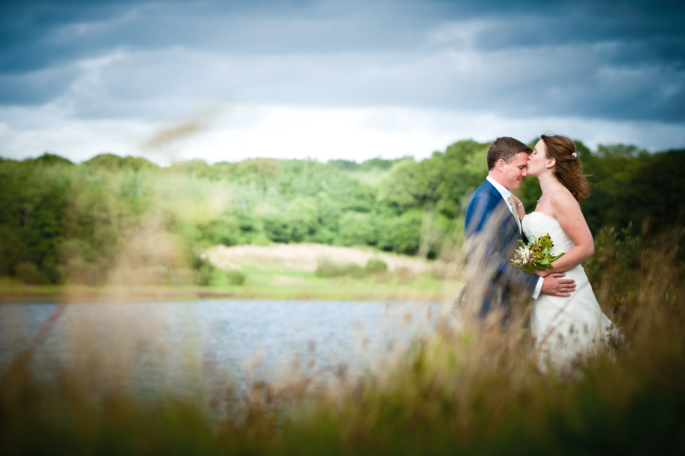 roadford lake wedding photographer - bride and groom next to the lake