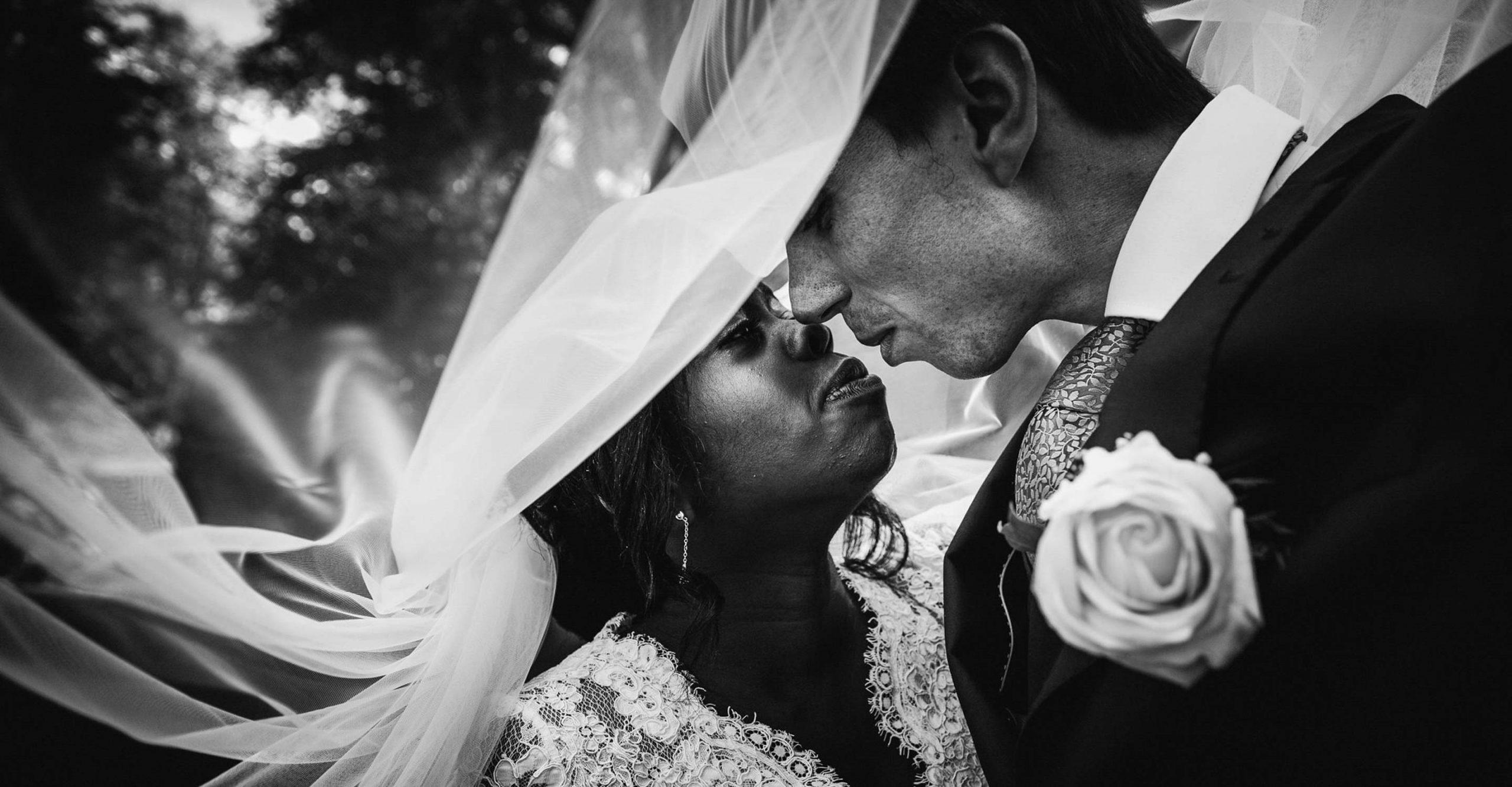 bride & groom under veil, hartnoll hotel wedding photographer in devon