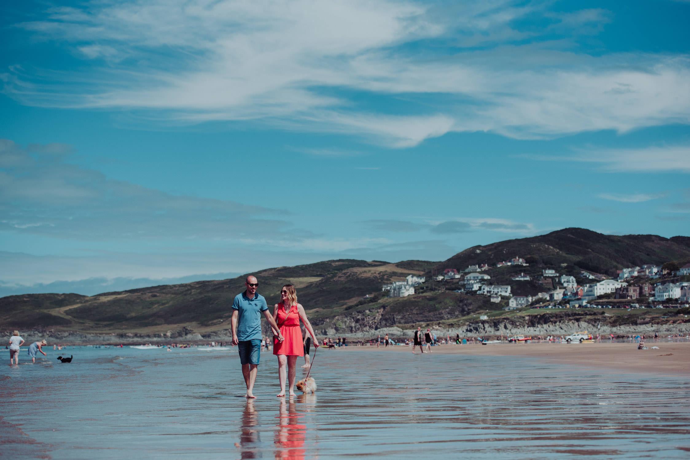 woolacombe-wedding-photographer-north-devon, couple with dog walking along woolacombe beach in north devon, north devon wedding photographer
